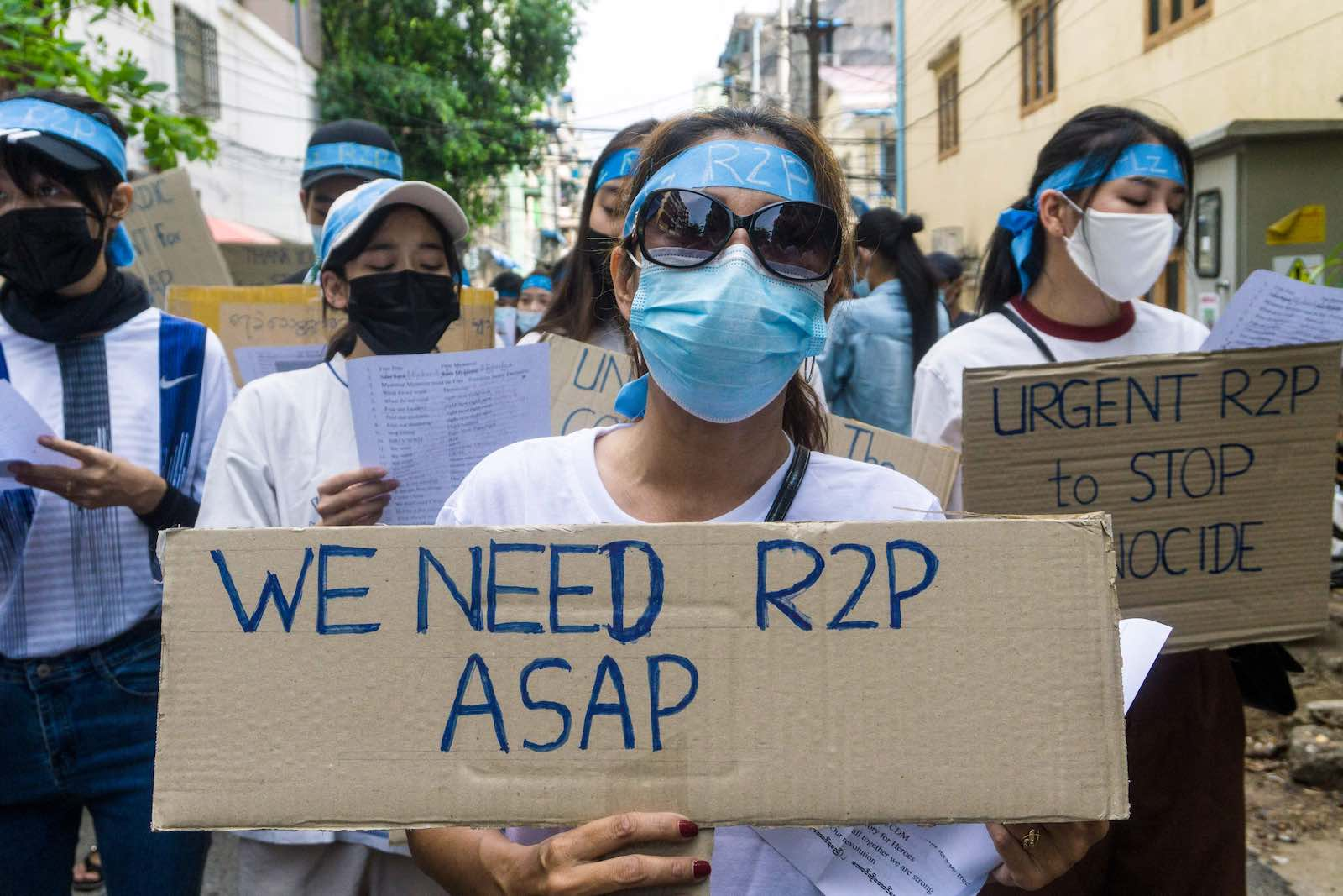 Protesters against the military coup in Myanmar call for international intervention, Yangon, 12 April 2021 (STR/AFP via Getty Images)