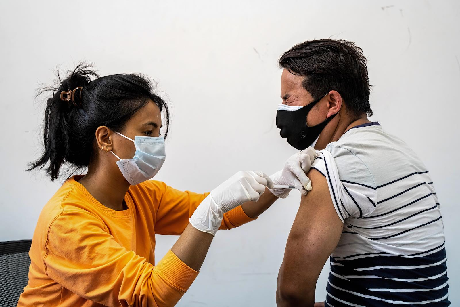 A Nepali man taking his first jab of Sinopharm vaccine at a health facility in Kathmandu, 26 April (Dipendra Rokka/SOPA Images/LightRocket via Getty Images)