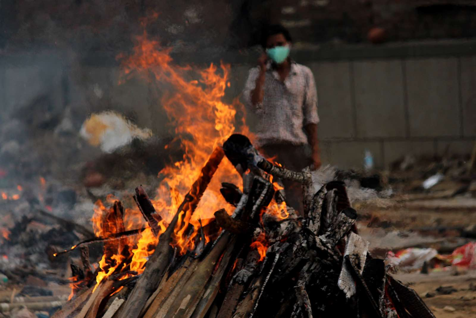 A burning pyre at a makeshift crematorium in Delhi, India on 1 May (Mayank Makhija/NurPhoto via Getty Images)