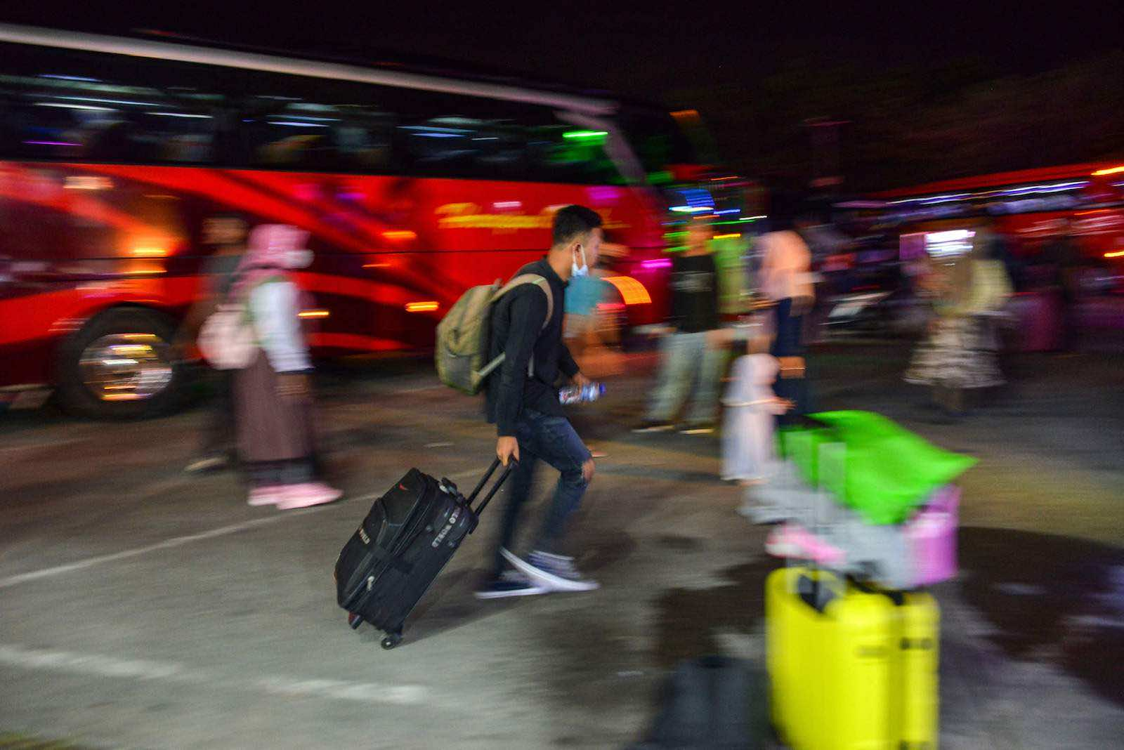 Passengers gather at a bus station during the homecoming, or mudik, ahead of the Eid al-Fitr celebrations in Banda Aceh, 3 May 2021 (Chaideer Mahyuddin/AFP via Getty Images)