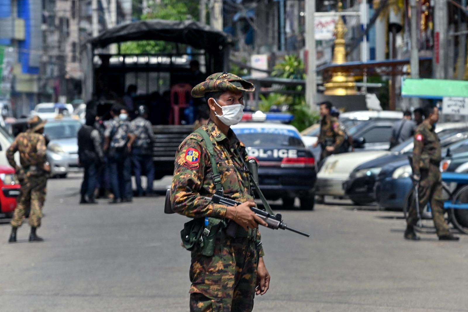 A soldier stands guard as security forces search for protesters who had been taking part in a demonstration in Yangon, 7 May 2021 (STR/AFP via Getty Images)