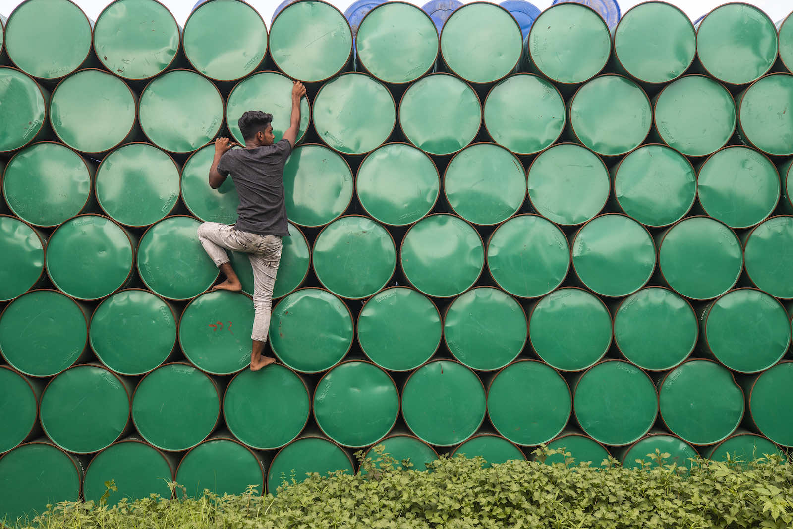 Empty oil drums at a warehouse in Narayanganj on 19 May (Ahmed Salahuddin/NurPhoto via Getty Images)