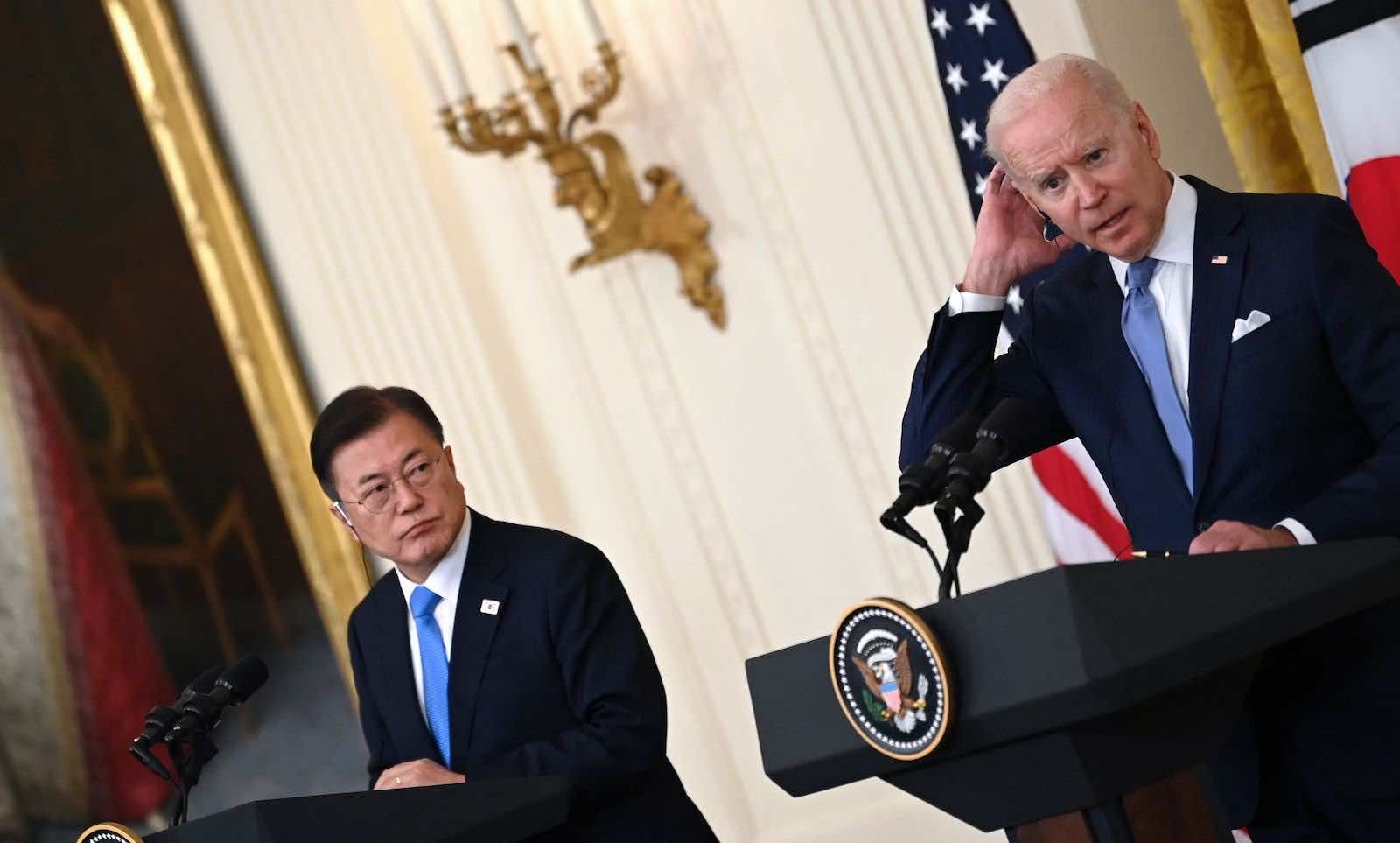 South Korean President Moon Jae-in and US President Joe Biden in the East Room of the White House on 21 May (Brendan Smialowski/AFP via Getty Images)