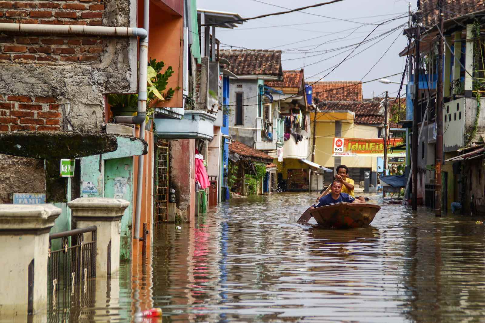 Flooding in Indonesia's Bandung district from overflow of the Citarum River, which displaced nearly 60,000 people, 24 May 2021 (Algi Febri Sugita/NurPhoto via Getty Images)