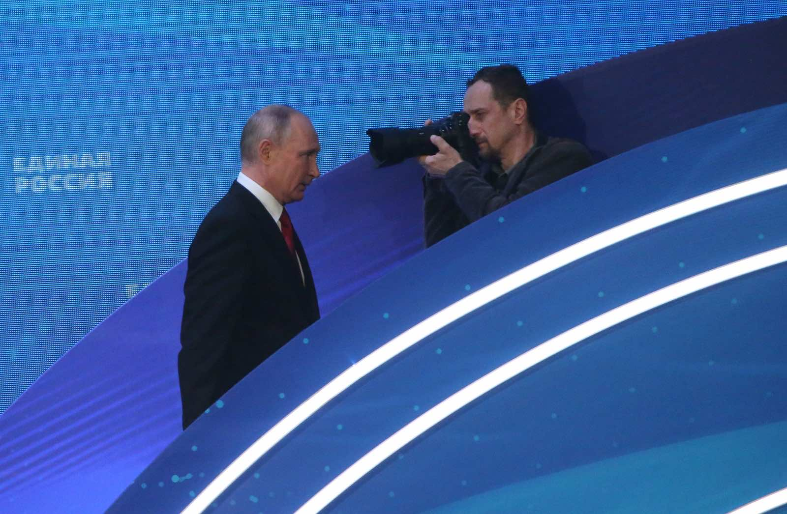 Russian President Vladimir Putin leaves after a speech at the 20th Congress of the United Russia Party in Moscow, 19 June 2021 (Mikhail Svetlov/Getty Images)