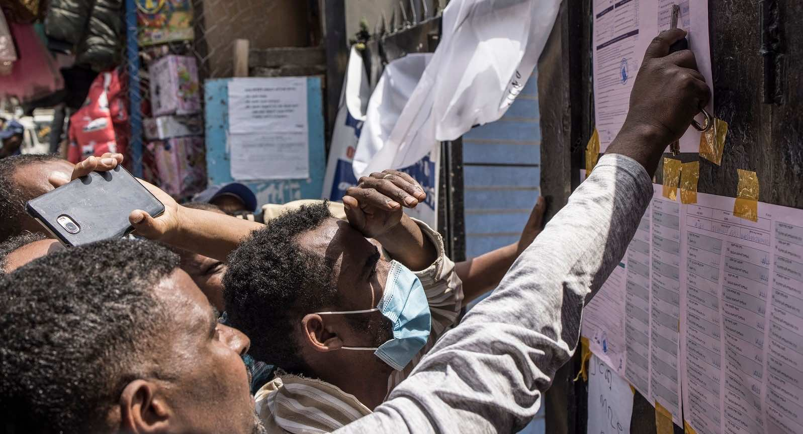 Voters check tallies at a polling station in Addis Ababa, 22 June 2021 (Marco Longari/AFP via Getty Images)