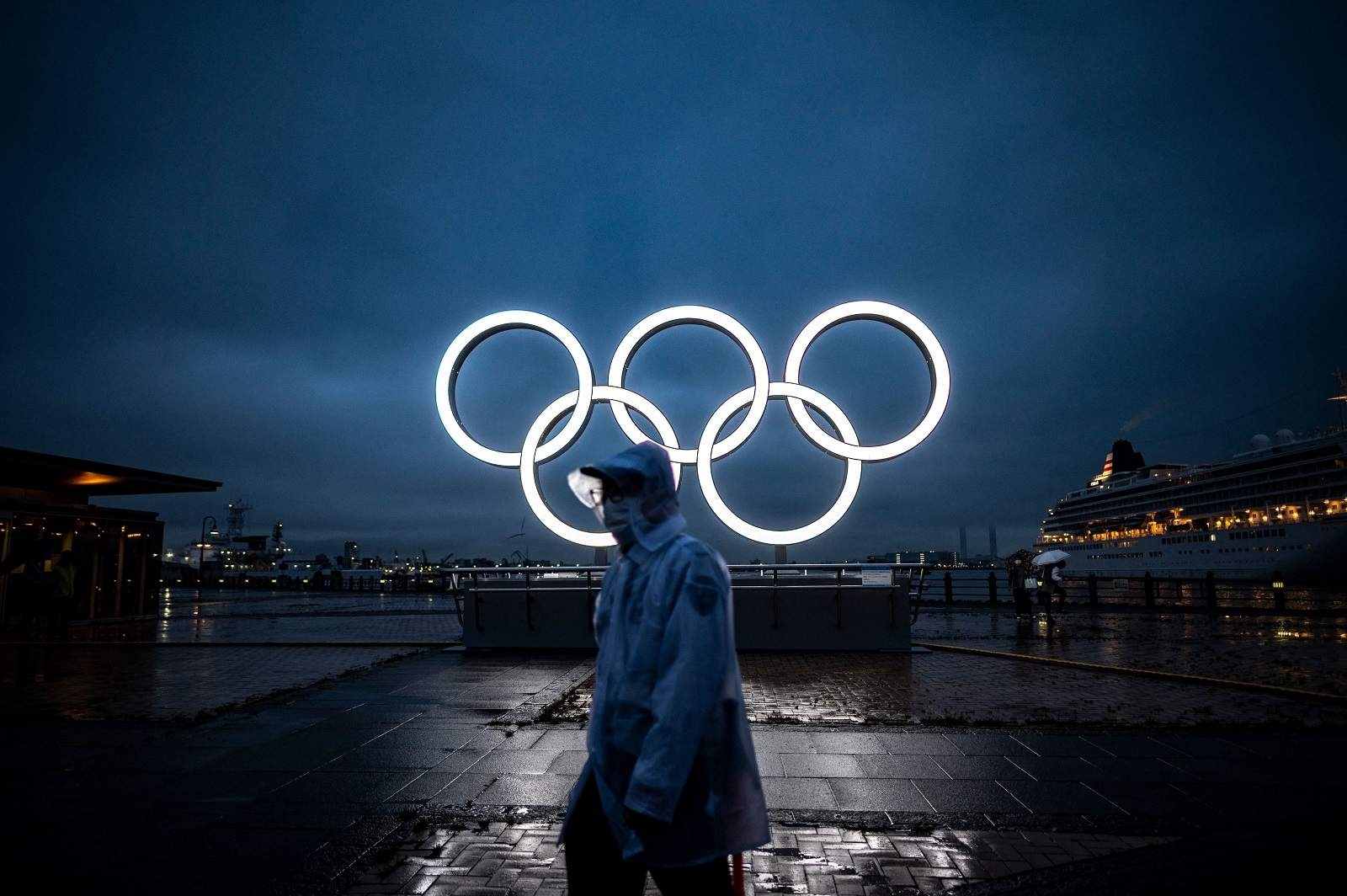 Olympic rings for the delayed Tokyo 2020 Summer Games light up at dusk in Yokohama, 2 July 2021 (Philip Fong/AFP via Getty Images)