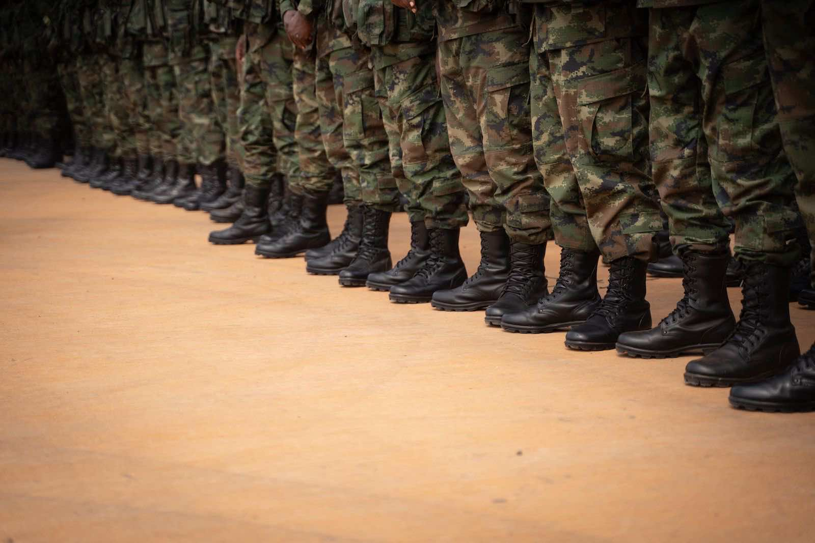 Rwandan soldiers and police prepare to deploy to Mozambique from Kigali airport on 10 July (Simon Wohlfahrt/AFP via Getty Images)