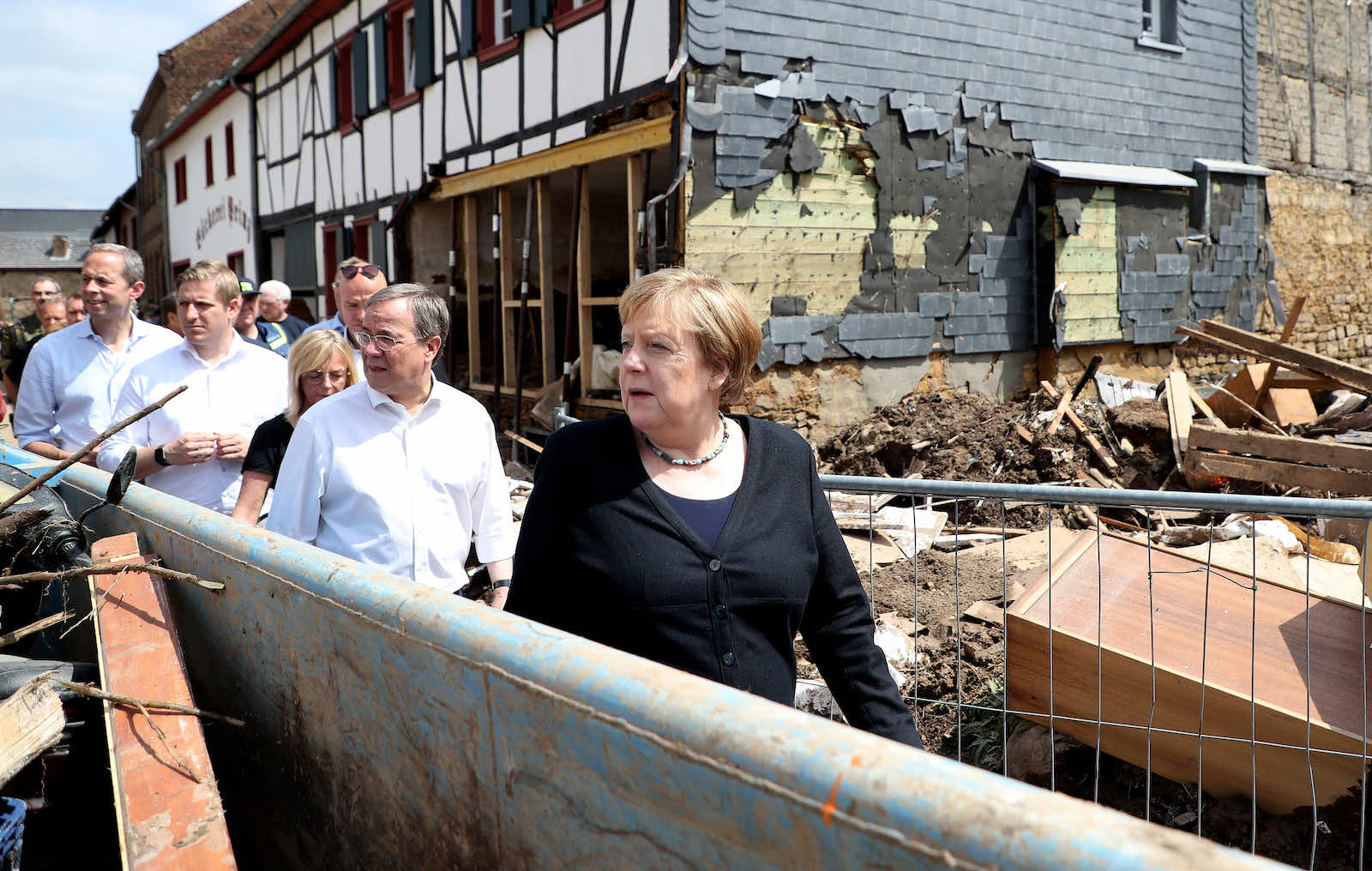 German Chancellor Angela Merkel inspecting damage after heavy flooding in the village of Bad Muenstereifel on 20 July. Merkel was accompanied by Armin Laschet, seen as a favourite to take over the chancellor position (Friedemann Vogel via Getty Images)