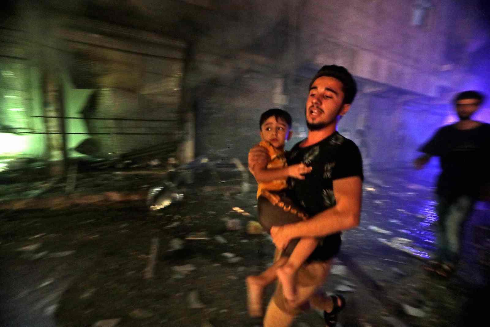 Fleeing a bombardment in the rebel-held city of al-Bab, northwest of Aleppo, northern Syria, on 6 August (Bakr Alkasem/AFP via Getty Images)