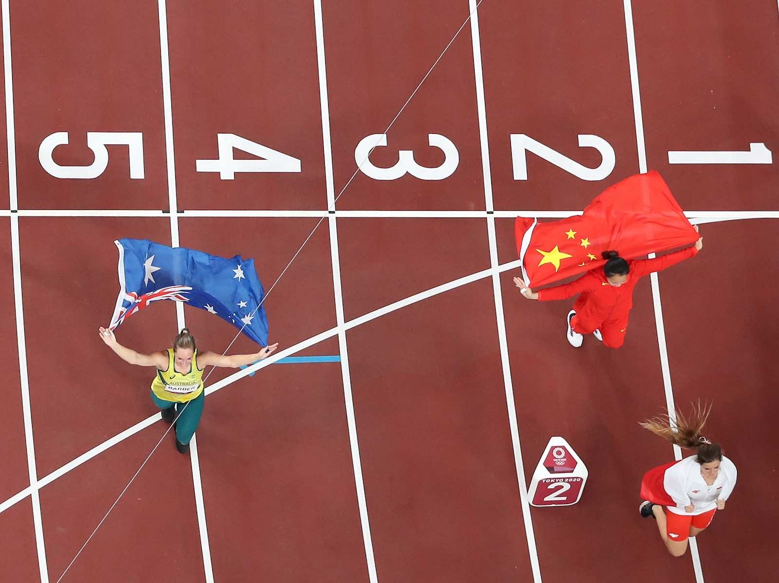 Kelsey-Lee Barber of Australia and Liu Shiying of China celebrate after the women's javelin throw final at the Tokyo 2020 Olympic Games, 6 August (Lui Siu Wai/Xinhua via Getty Images)