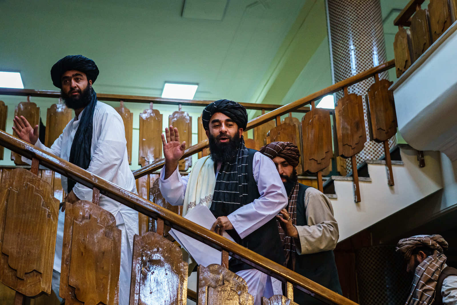 Taliban spokesman Zabihullah Mujahid makes his first-ever public appearance to address concerns about the Taliban's reputation with human and civil rights during a press conference in Kabul, Afghanistan (Marcus Yam/Los Angeles Times via Getty Images)