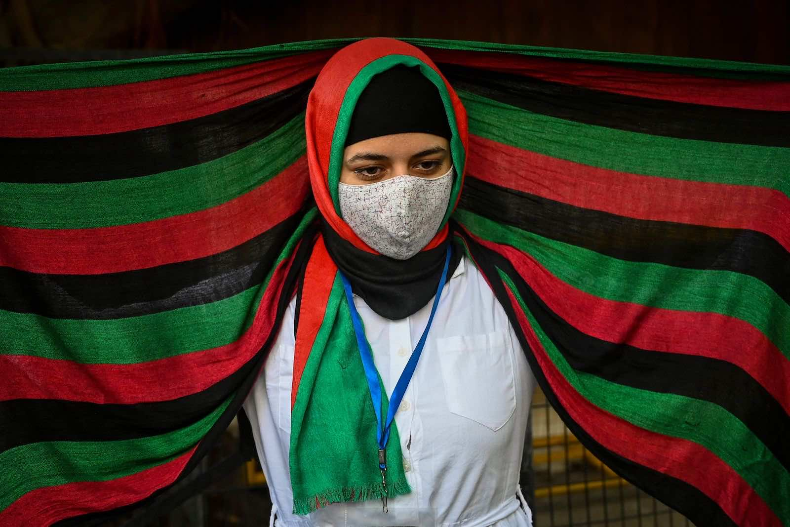 Afghans residing in India demonstrate outside the UN Refugee Agency office in New Delhi on 23 August to protest against the Taliban's military takeover of Afghanistan (Sajjad Hussain/AFP via Getty Images)