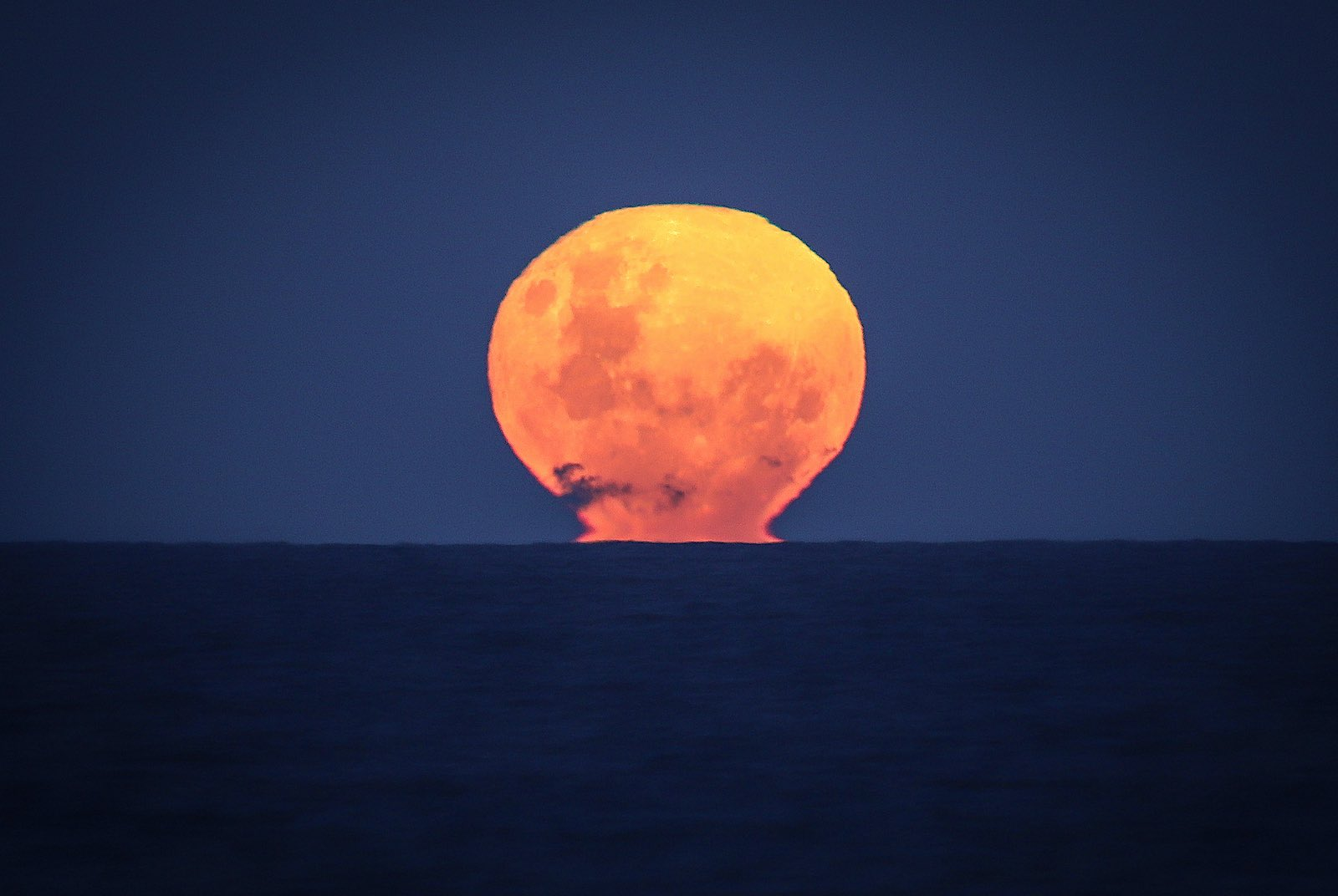 Moonrise over the Pacific ocean at Narrawallee Beach, on the south coast of New South Wales in Australia, 6 June 2020 (David Gray/Getty Images)