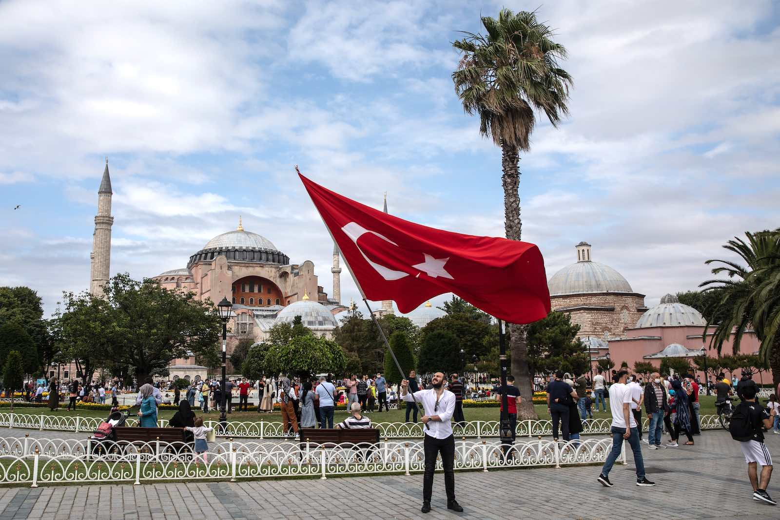 A man waves Turkey's flag near the Hagia Sophia Mosque on the fourth anniversary of the 2016 failed coup attempt, Istanbul, 15 July 2020 (Chris McGrath/Getty Images)