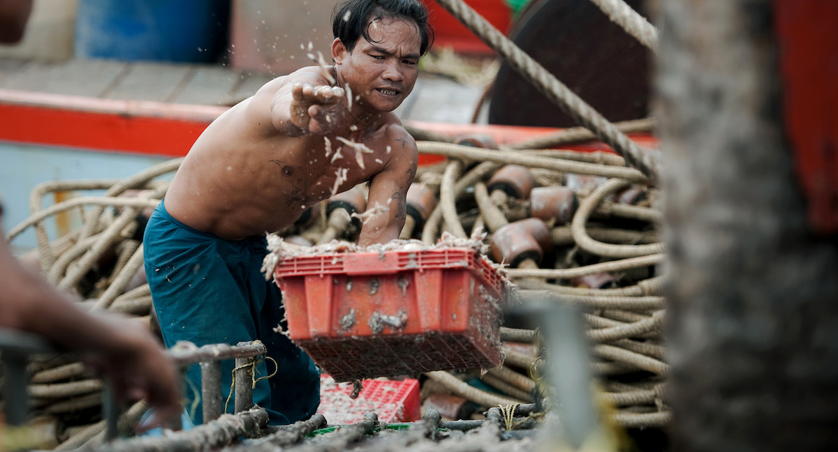 Thousands of men set sail on Thai fishing boats every day, slaves forced to work in brutal conditions under threat of death. (Photo: Nicolas Asfouri via Getty)