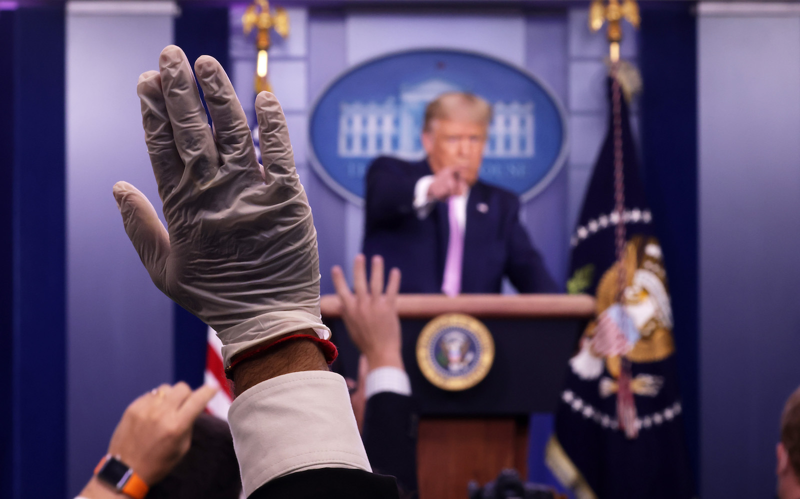 US President Donald Trump takes questions during a new conference at the White House, 11 August 2020 (Alex Wong/Getty Images)