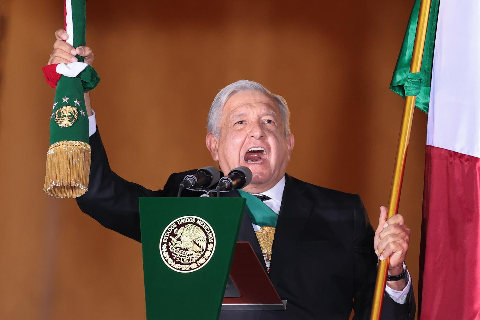 """Mexican President Andrés Manuel López Obrador delivers the """"Cry of Dolores"""" to kick off Independence Day celebrations at the National Palace in Mexico City, 15 September 2020 (Hector Vivas/Getty Images)"""