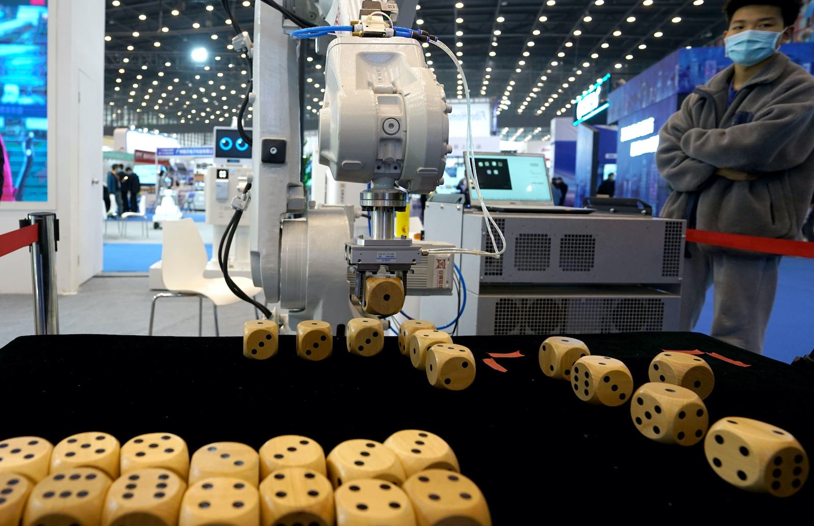 A robotic arm arranges dice during the 2021 World Digital Industry Expo in Zhengzhou, Henan province, China, 24 March 2021 (Ma Jian/VCG via Getty Images)