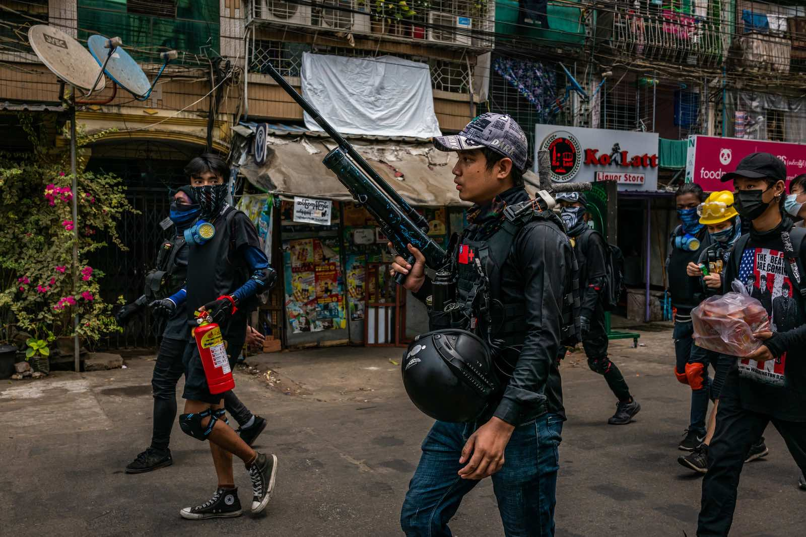 Anti-coup protesters carry improvised weapons during a protest on 3 April 2021 in Yangon, Myanmar (Stringer/Getty Images)