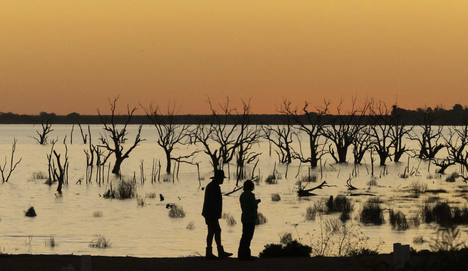 Watching the sunset over Lake Menindee in far-west New South Wales, which filled for the first time earlier this year after five years of drought, 17 May 2021 (Brook Mitchell/Getty Images)