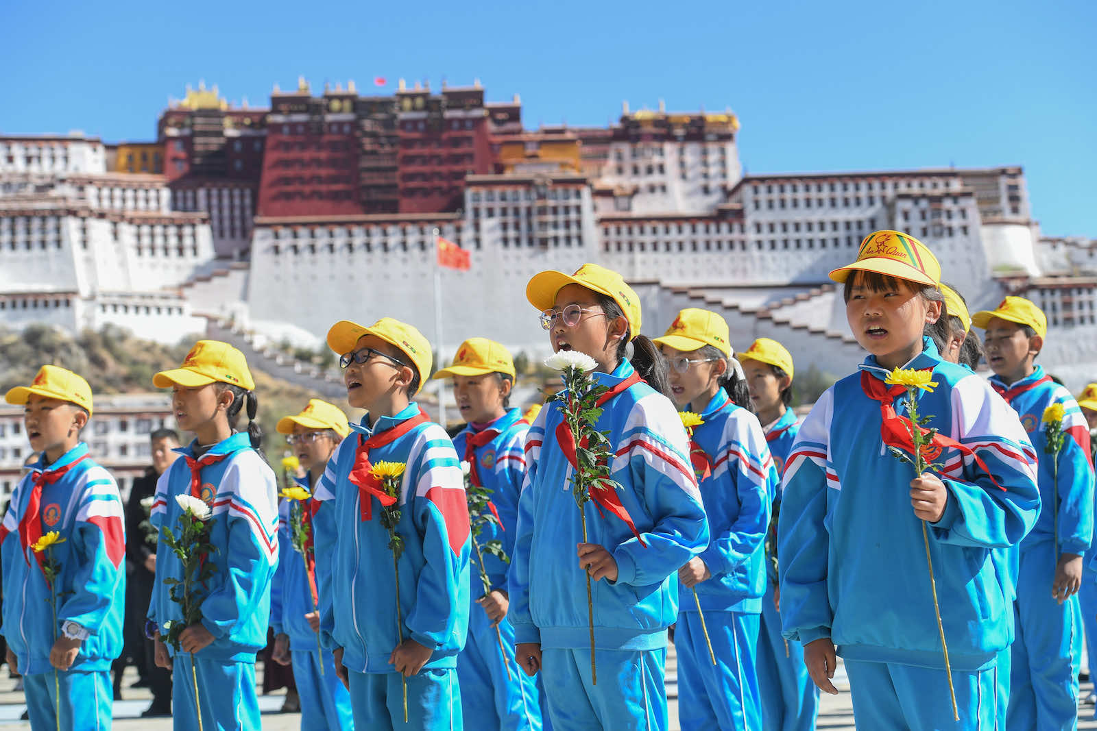"""Students sing to mark the 70th anniversary of the """"peaceful liberation"""" of Tibet, 23 May in Lhasa (Photo by Gongga Laisong/China News Service via Getty Images"""