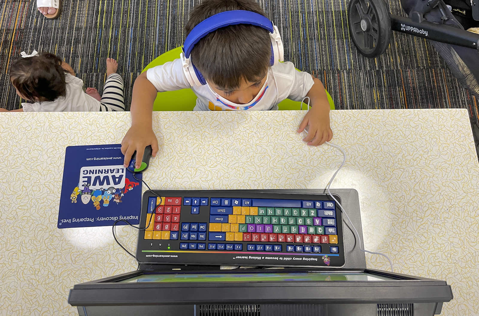 Playing an educational computer game LA County Library, Norwalk, United States (Jeff Gritchen via Getty Images)