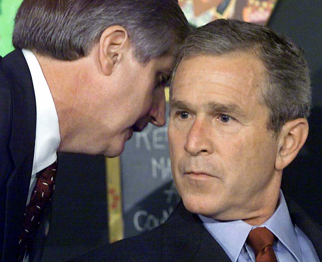 The moment US President George W. Bush has his early morning school reading event interrupted with news of New York, 11 September 2001 (Paul J. Richards/AFP via Getty Images)