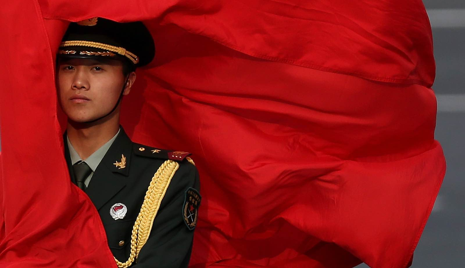 An honour guard outside the Great Hall of the People, Beijing, in 2013 during a visit by then prime minister Julia Gillard (Photo by Feng Li/Getty)
