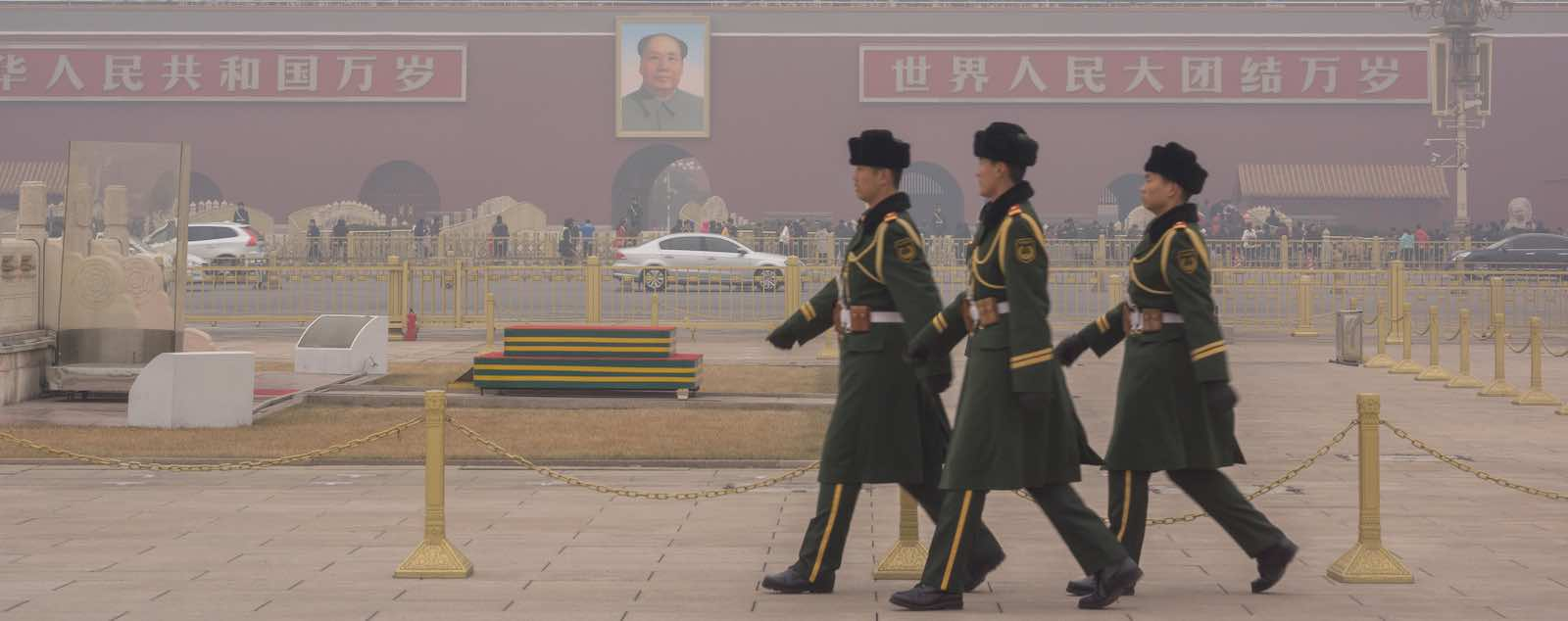 Guard soldiers walk through Tiananmen square in the heavy haze (Photo: VCG via Getty)