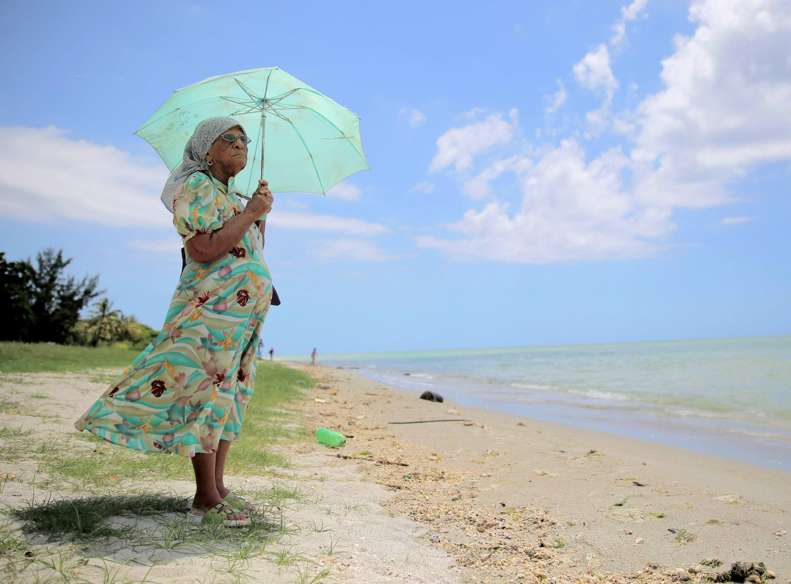 A 90-year-old woman who was exiled from the Peros Banhos Atoll of the Chagos Archipelago stands by the sea in March 2015 in Port Louis, Mauritius (The Asahi Shimbun via Getty Images)