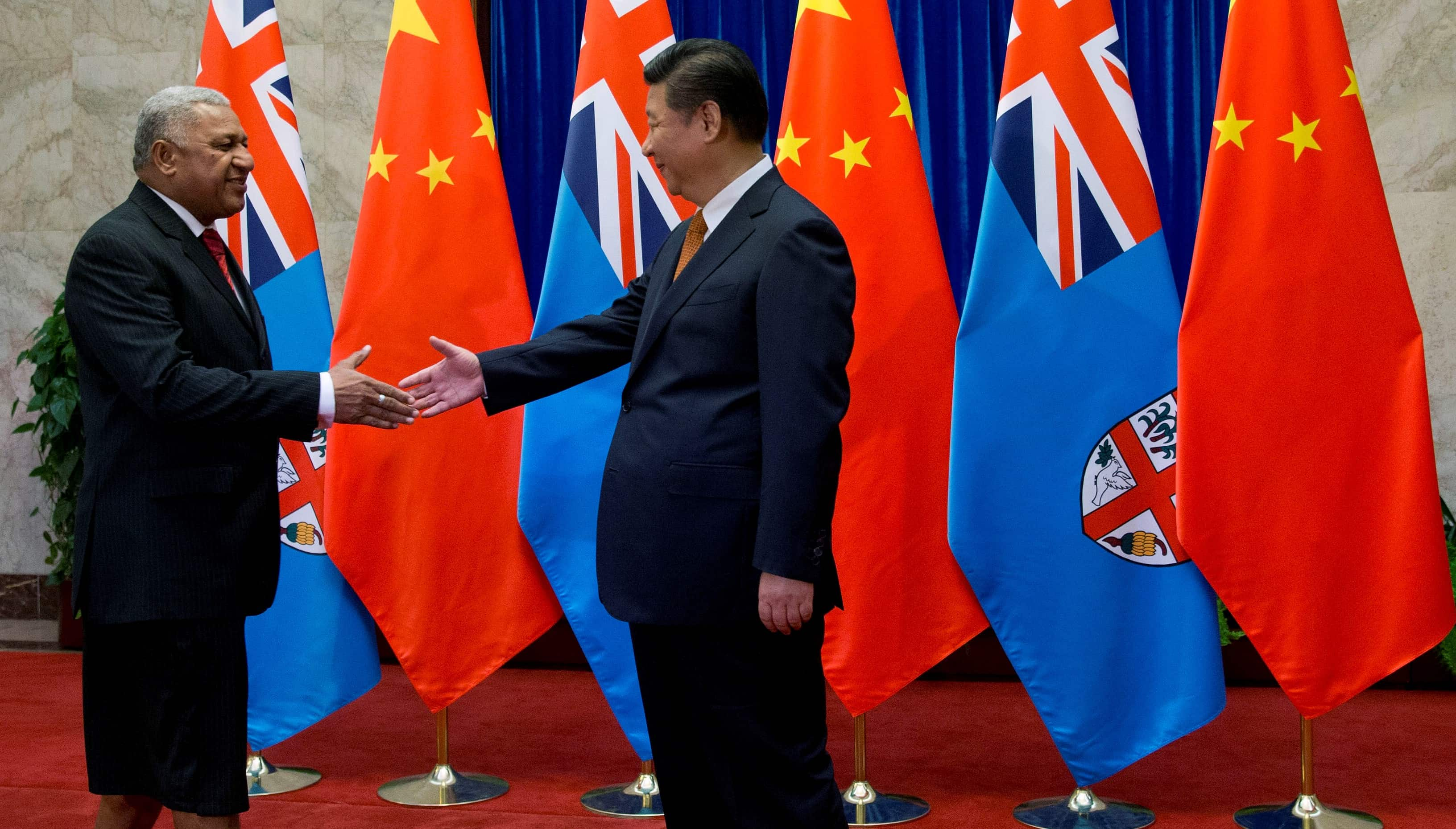 Fijian Prime Minister Frank Bainimarama and Chinese President Xi Jinping, July 2015 (Photo: Andy Wong/Getty Images)