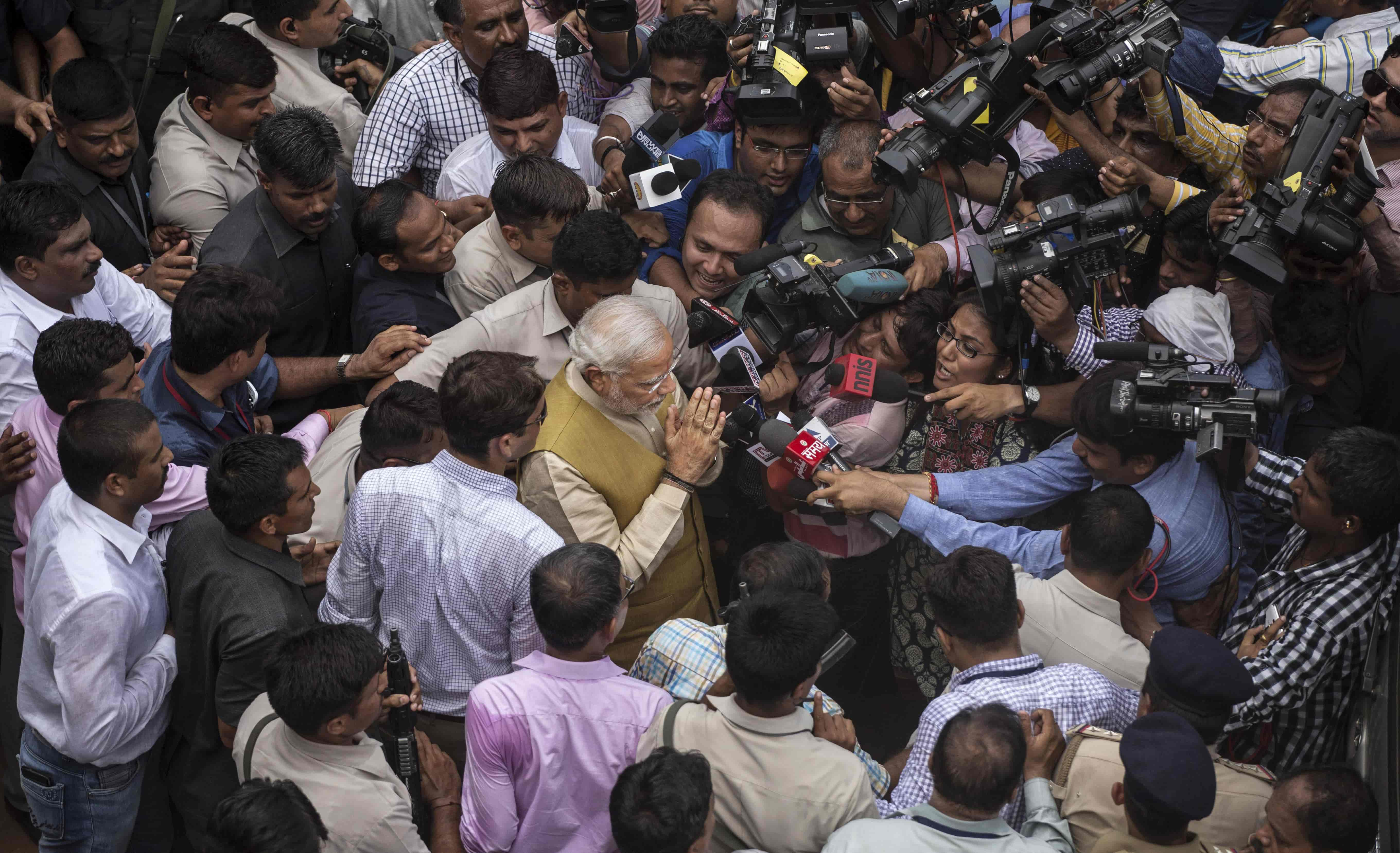 India's Narendra Modi mobbed in a press pack (Photo: Kevin Frayer/Getty)