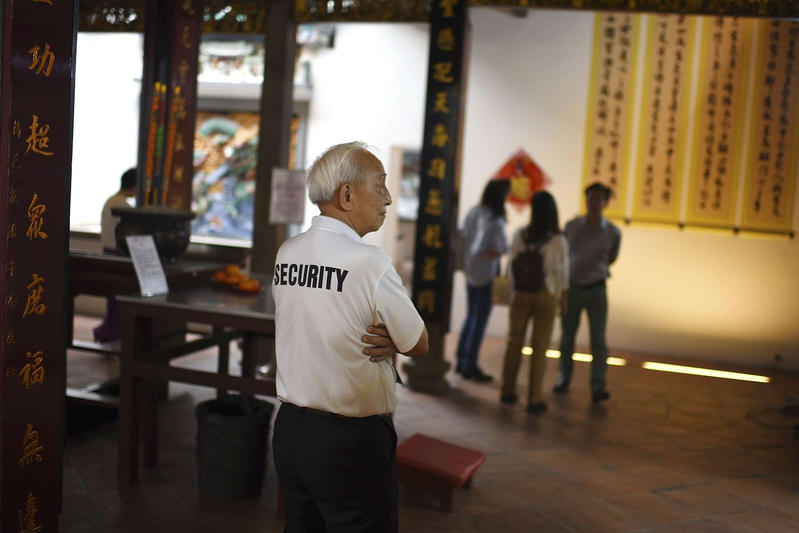 Wong, a 72-year-old security guard, keeps watch at temple during the Chinese New Year in Singapore, February 2016. (Borja Sanchez-Trillo/Getty Images)