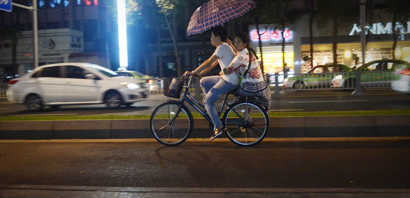 People can peddle faster, but will they get ahead? (Photo: Wang Zhao via Getty)