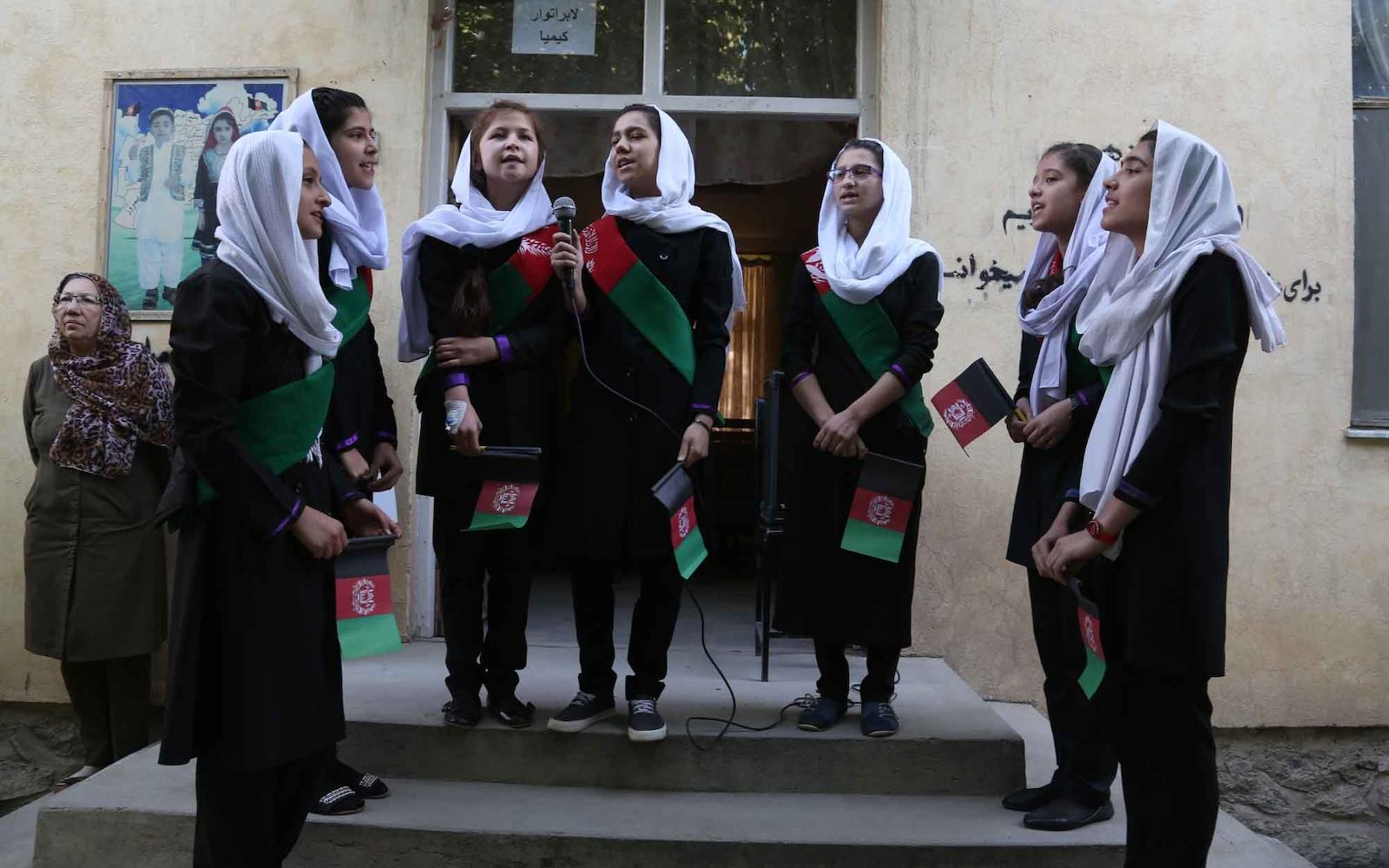 Afghan girl students sing the national anthem before classes at Surya High School in Kabul, September 2016 (Xinhua/Rahmat Alizadah via Getty Images)