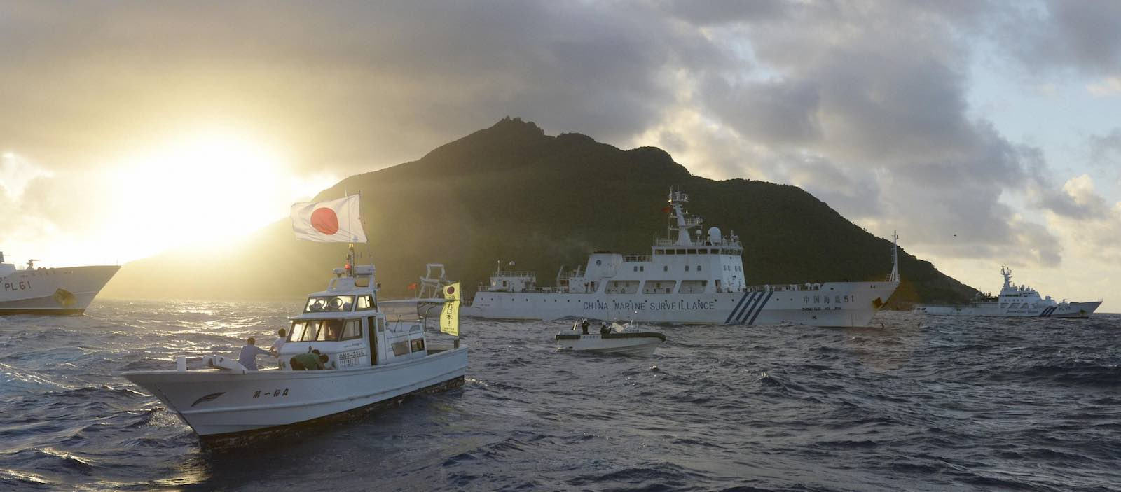 Chinese and Japanese vessels passing in 2013 near the disputed Senkaku/Diaoyu Islands in the East China Sea (Photo: Kyodo News Stills via Getty Images)