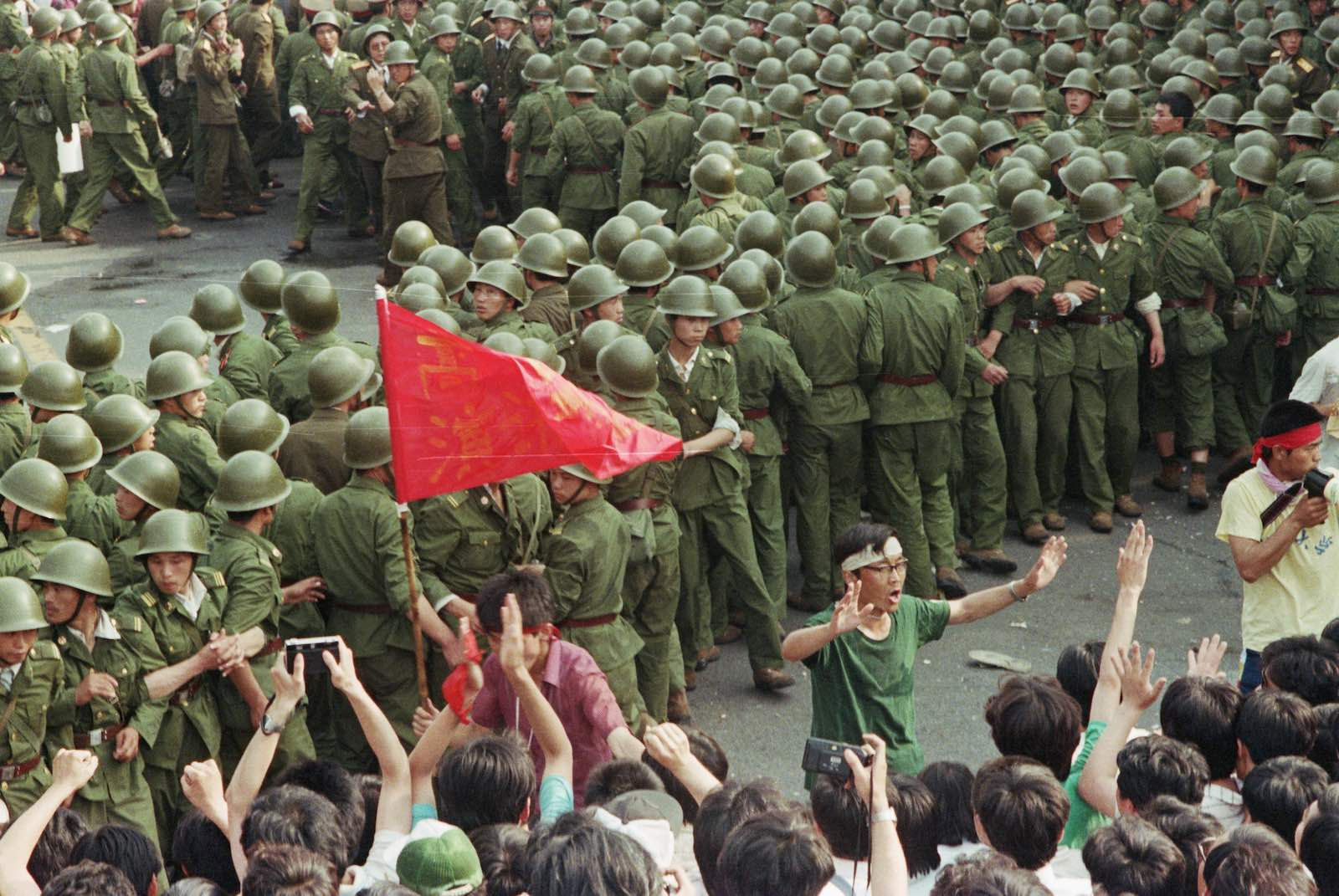 Soldiers and demonstrators at Tiananmen Square (Photo: David Turnley via Getty)