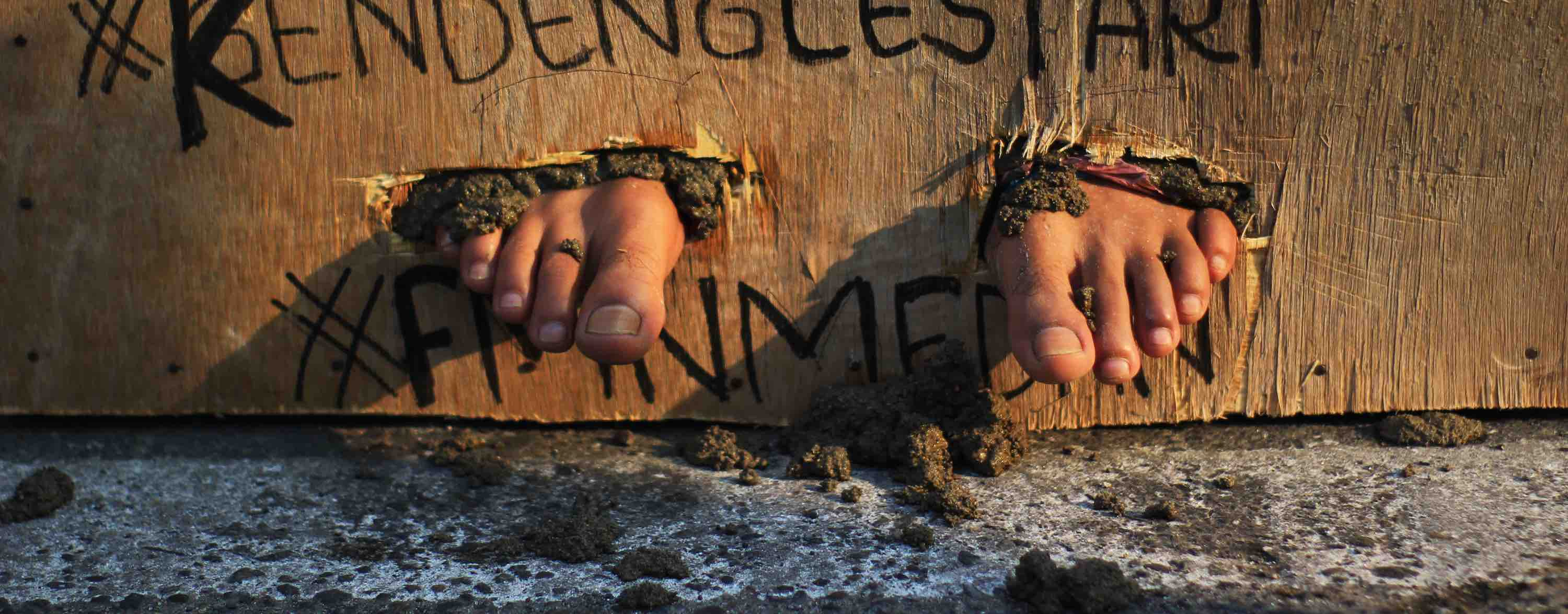Protesters feet cemented in March 2017 in support for Kendeng farmers in Medan, Indonesia (Photo: Lana Priatna via Getty Images)