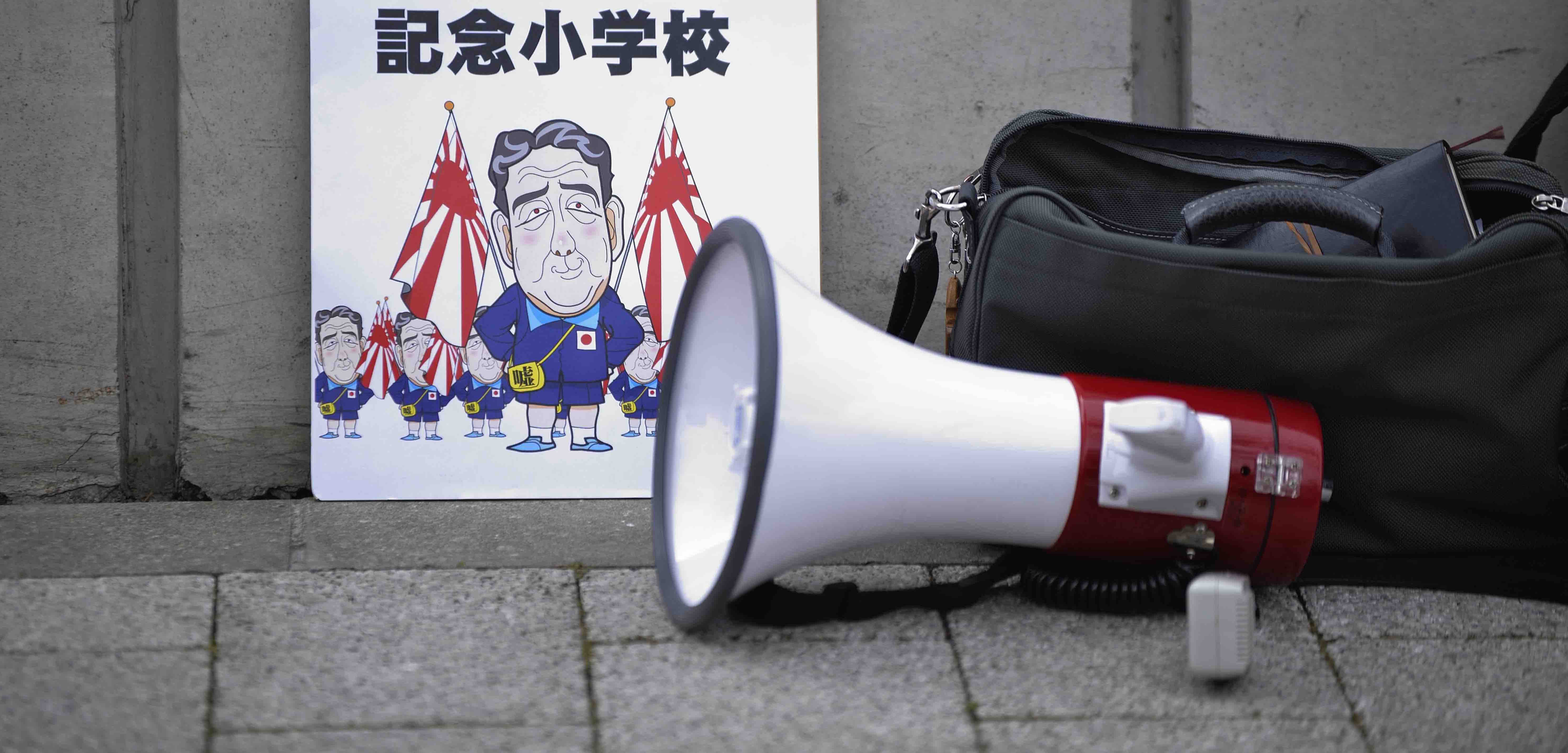 Protest placard against Japanese Prime Minister Shinzo Abe outside the Diet in March 2017 (Photo: David Mareuil/Getty)