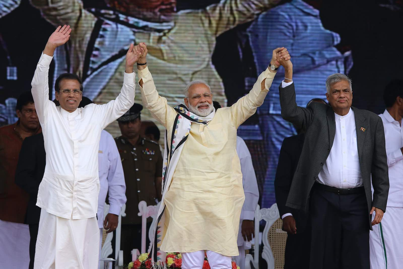 Indian Prime Minister Narendra Modi (centre) with Sri Lankan President Maithripala Sirisena (L) and Sri Lankan Prime Minister Ranil Wickremesinghe during a rally in Norwood, Sri Lanka, May 2017 (Photo: Tharaka Basnayaka via Getty)