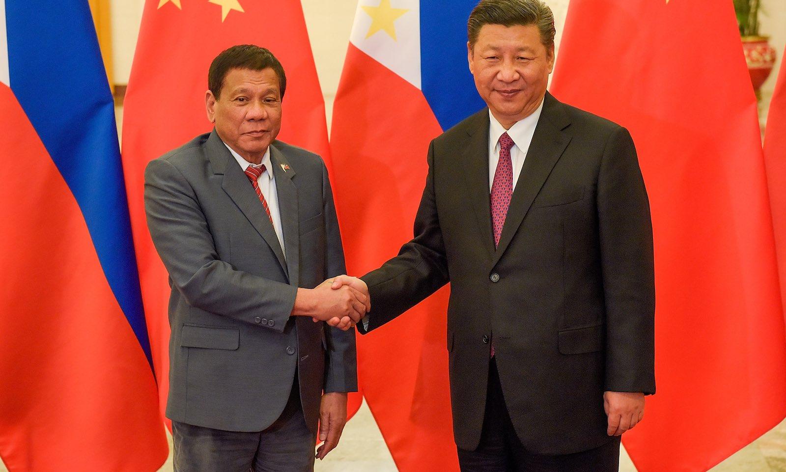 Philippines President Rodrigo Duterte in Beijing meeting China's Xi Jinping in 2017 (Photo: Etienne Oliveau/Getty)