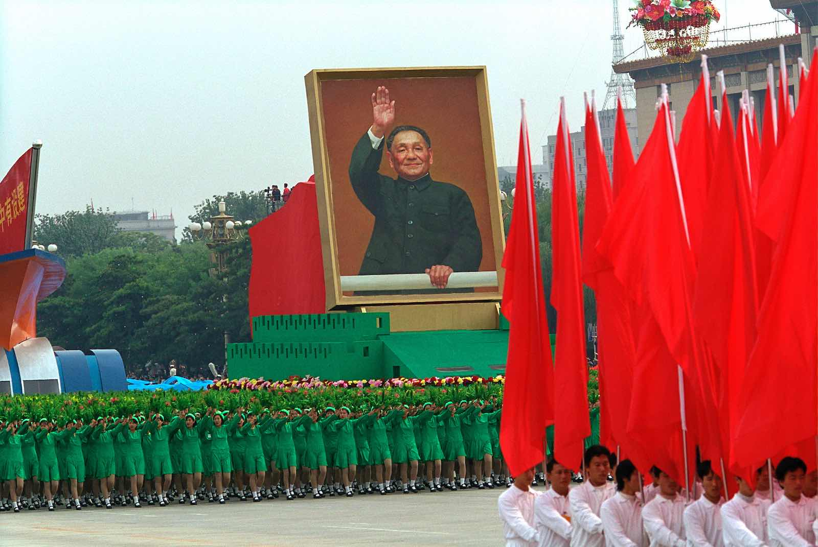 A portrait of Deng Xiaoping is displayed during a parade marking the 50th anniversary of the People' s Republic of China, Tiananmen Square, Beijing, 1 October 1999 (Photo: David Hume Kennerly/Getty Images)