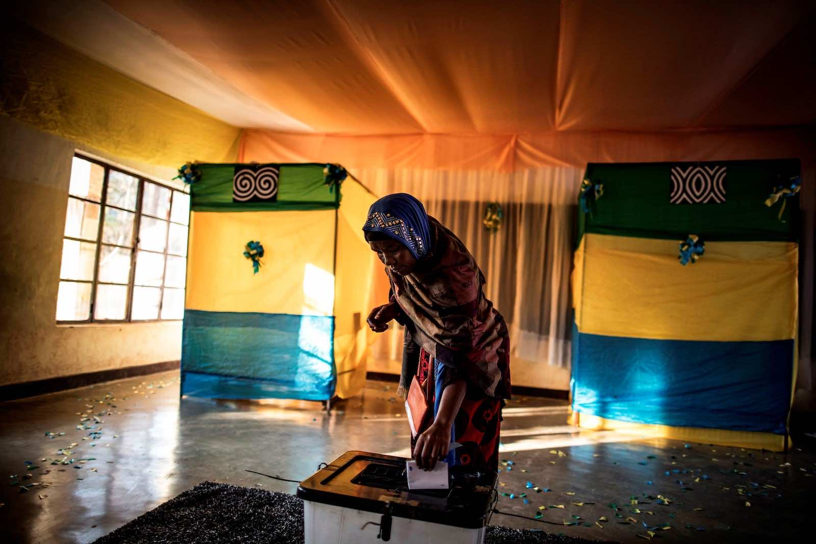 A woman casts her vote at a polling station in Kigali on 4 August 2017 (Marco Longari/AFP via Getty Images)