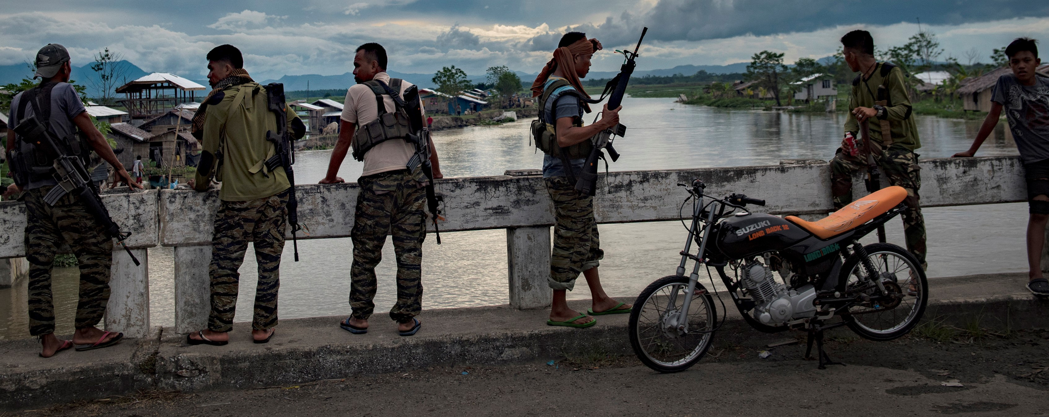 Moro Islamic Liberation Front Fighters guarding a bridge, Maguindanao Province, Mindanao, the Philippines, August 2017 (Photo: Getty Images/Jes Aznar)