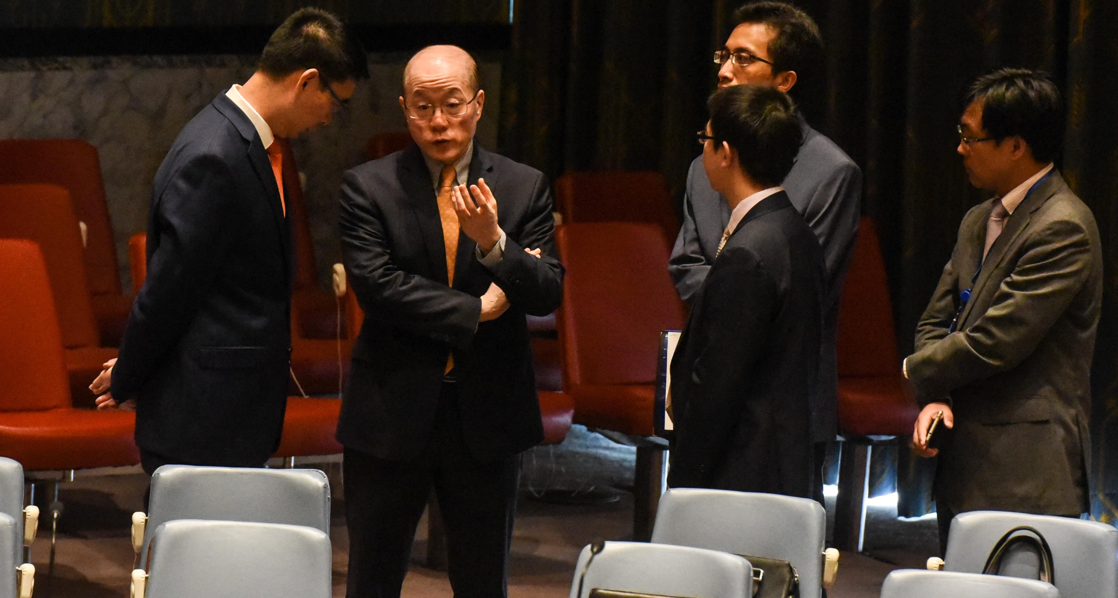 Chinese Ambassador to the UN Liu Jieyi speaks with his team during an emergency UN Security Council meeting to discuss North Korea's nuclear test, September 2017 (Photo: Getty Images/Stephanie Keith)