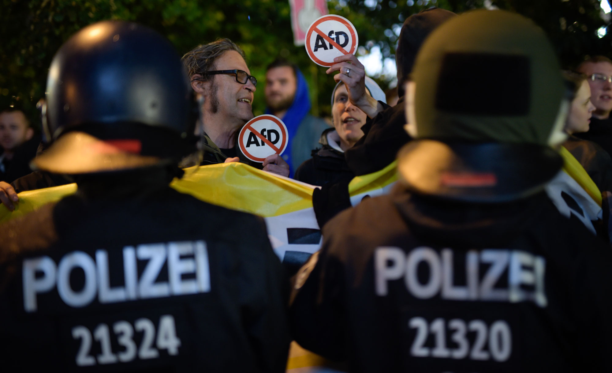 Opponents of the Alternative for Germany (AfD) protest after the German federal elections. Photo by Jens Schlueter/Getty Images
