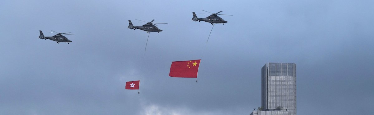 Towing the Chinese and Hong Kong flags to celebrate China's national day in Hong Kong (Photo: Anthony Wallace via Getty)