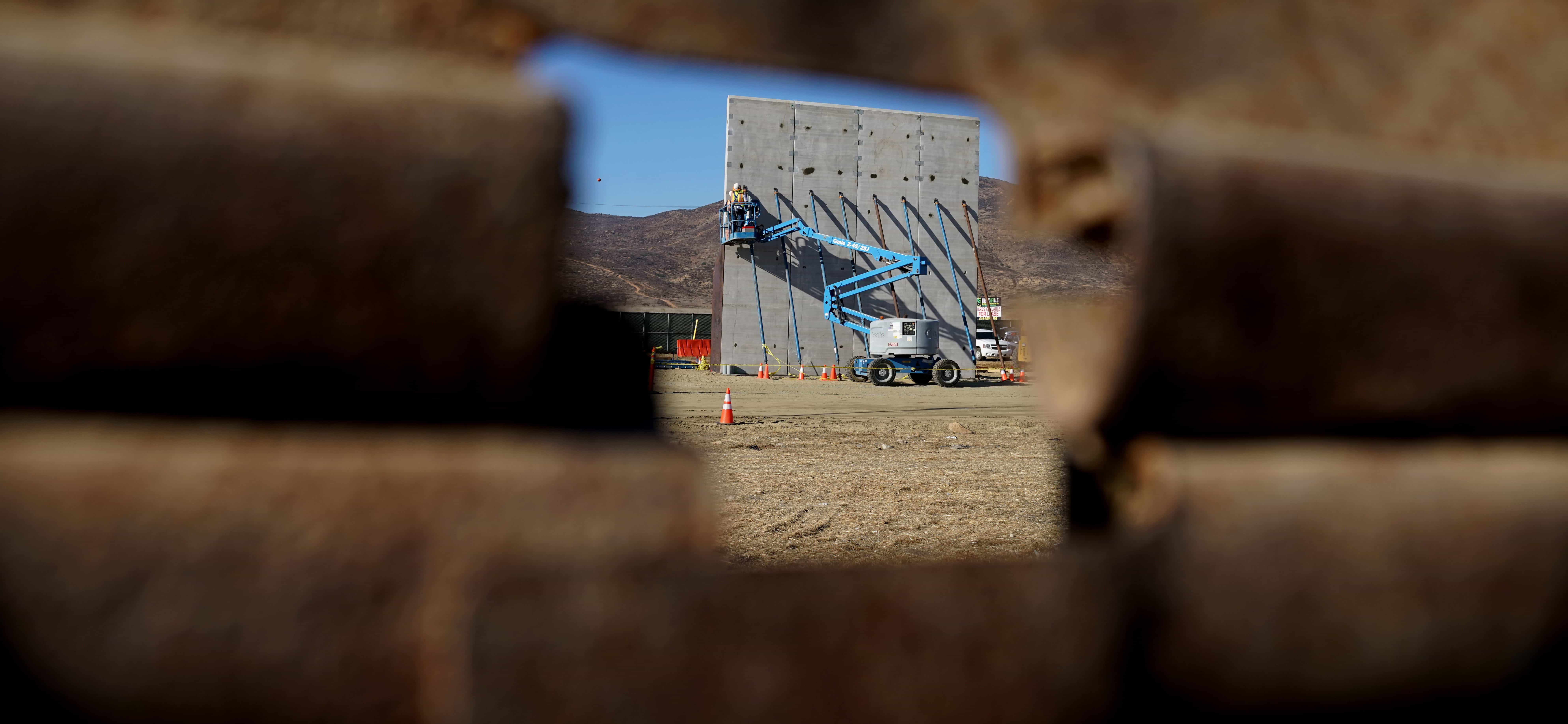 Prototypes of possible border walls between the US and Mexico under construction, October 2017 (Photo: Sandy Huffaker/Getty Images)