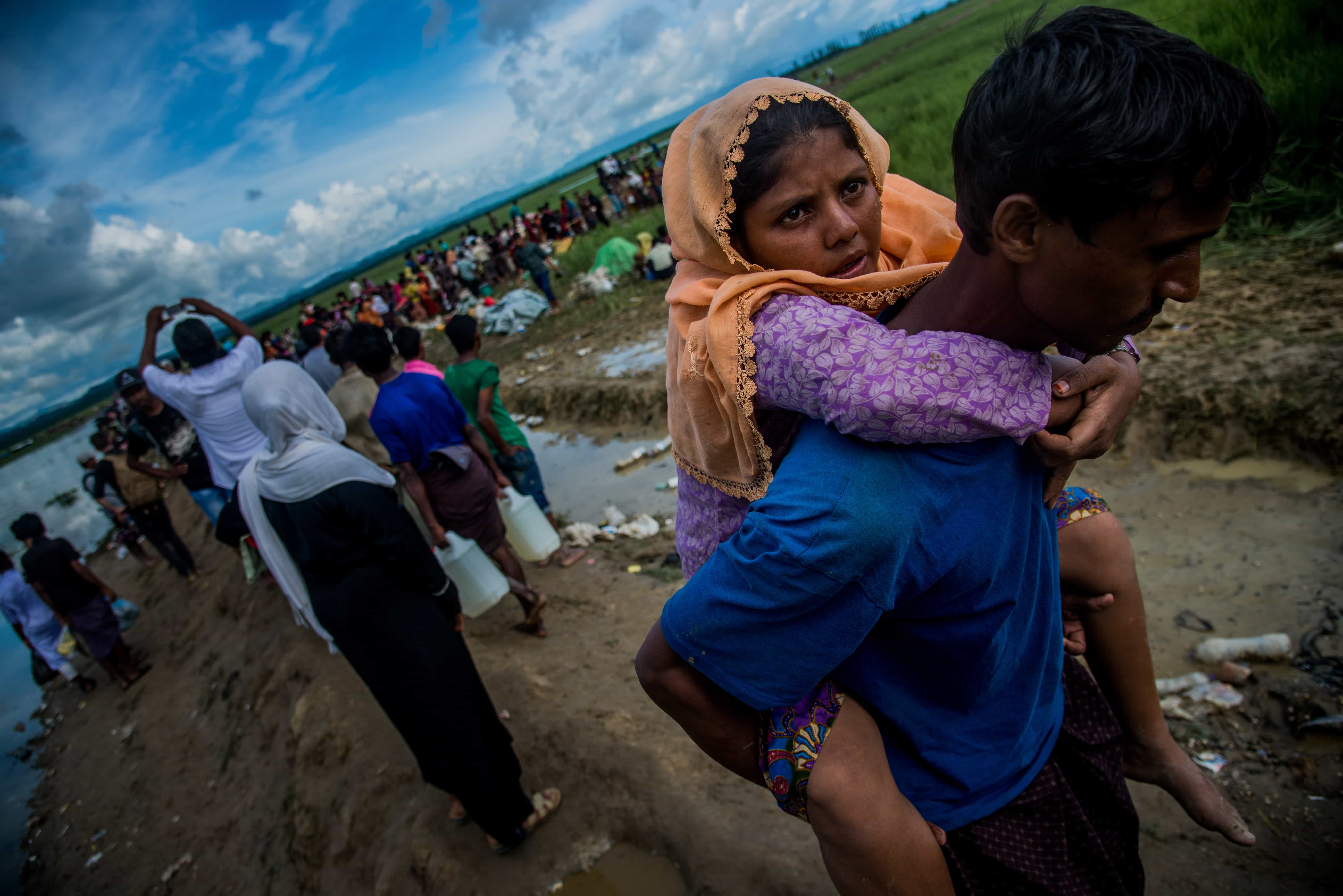 Rohingya attempting to cross the border between Myanmar and Bangladesh, October 2017 (Photo: Stringer/Anadolu Agency/Getty Images)